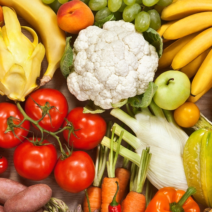 Photo of tomatoes, cauliflower, bananas, carrots, apples, peaches, potatoes and grapes